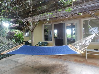 Relax under tropical flower arbor.