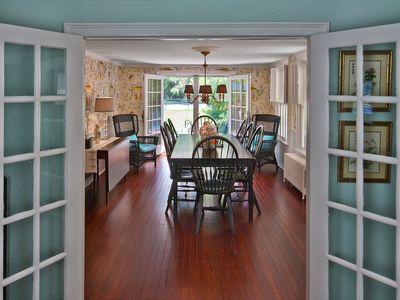 Dining room overlooking pool and tennis court; French doors to kitchen