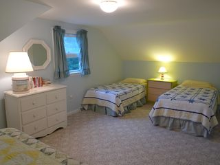 Dennisport house photo - Second view of the kids' large 15' X 21' bedroom with queen and two twin beds.