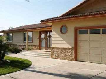 Morro Bay house rental - Stacked Stone Facade with Hand Carved Mahogany Front Door- 'The Palms'