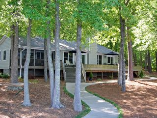 Lake Gaston house photo - front of the house-faces the lake; screened porch on left, paved walkway to lake