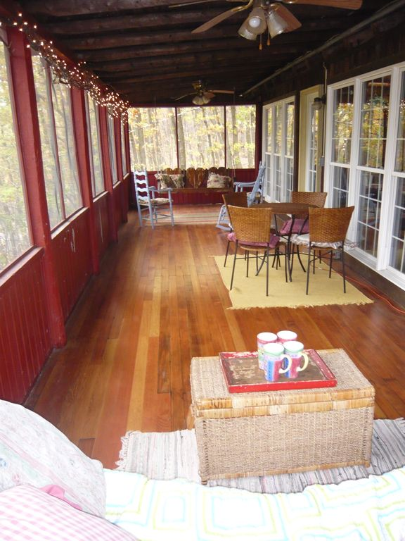 screened porch with swing, table/chairs, settee