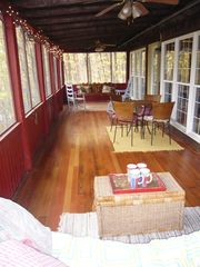 Harpers Ferry cabin photo - screened porch with swing, table/chairs, settee