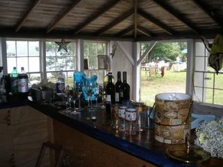Dennis Village cottage photo - Enjoy the boathouse bar that overlooks lake and lawn.
