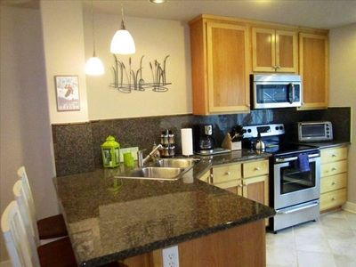 Large kitchen with granite counter, stainless appliances