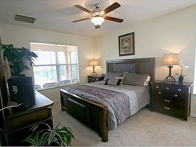 Master Bedroom with upgraded furnishings and linens, Ceiling Fan and TV