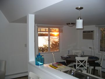 View from living room into dining area of kitchen at sunset.