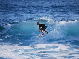 Poipu condo photo - SURF CONTEST AT FAMOUS PK'S IN FRONT OF YOU. (zoomed from lanai).