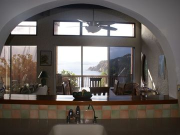 View from the kitchen through arched 'pass through'!