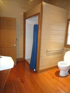 The handicapped shower & bath in the Deer Cabin. All 5 toilets have hand rails.