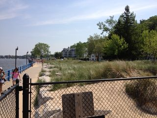 Grand Haven house photo - The Channel Boardwalk is always relaxing and beautiful. House in middle of pic.
