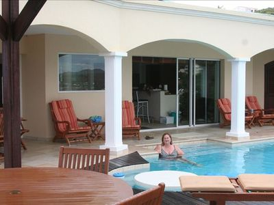 Relaxing in private pool large enough for laps, kitchen in background