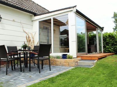 House in Steinhude, a privileged location, with terrace, winter garden + fireplace