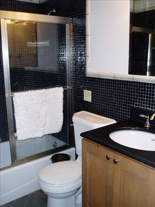 Renovated / glass tiled bathroom.