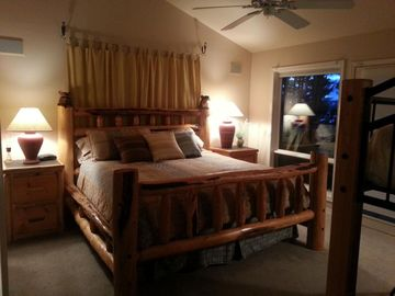 Master Suite w/plush king bed has a futon sofa w/upper bunk & sleeps family of 5