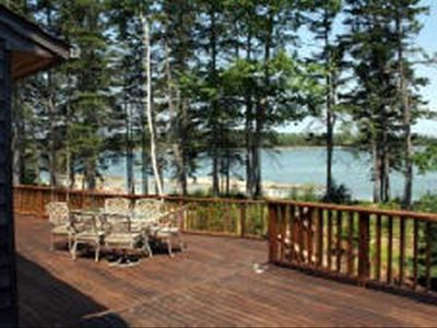 View from private and expansive deck facing the shoreline and nature preserve.