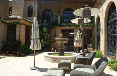 Relax by the courtyard fountain while taking in the beautiful surroundings.