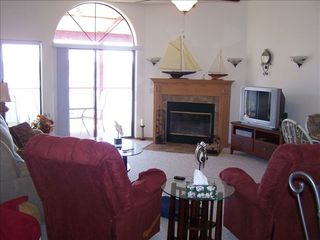 Lake Ozark condo photo - Living Room w/ fireplace overlooking the Lake