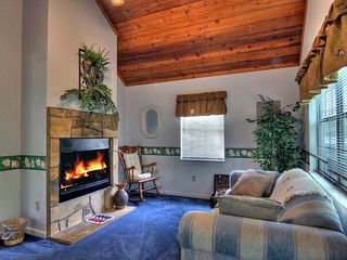 Pigeon Forge cabin photo - Cozy up to the double sided fireplace