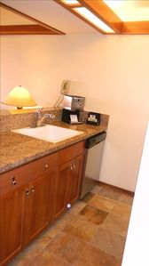 The fully-stocked kitchen overlooks the living area, ...easy to prepare meals.