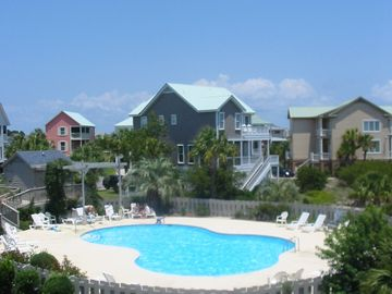 The condominium complex pool is conveniently located just steps away