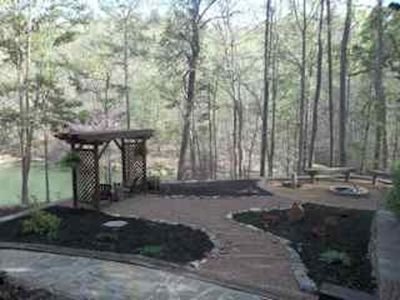 View of Fire Pit and Arbor from the main floor glassed in porch
