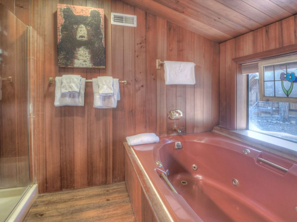 2 person jetted tub with view to the forest.