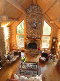 Show Low lodge rental - The cathedral ceiling living room wonderful wood fireplace with gas starter