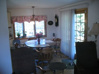 Old Lyme house photo - Kitchen area with deck outside behind it. Door on right leads to deck.