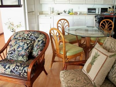 Fully equipped kitchen, dining room, and another easy chair