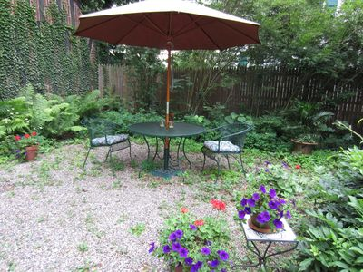 Your garden patio w.charcoal grill when you feel like dining or relaxing outdo.
