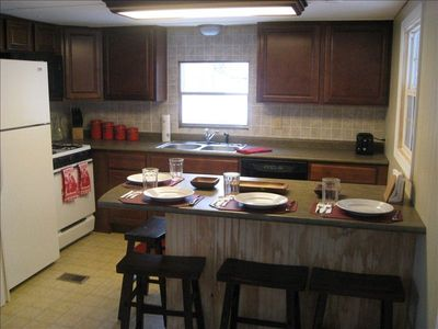 Nice, new kitchen. Features refrigerator, dishwasher, stove/oven, microwave oven