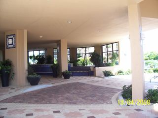 Cape Marco condo photo - Beautiful tiled and fountained secured entryway to the condo units