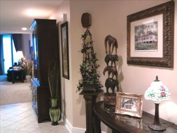 Biloxi condo rental - Entry way into residence lined with a personal touch