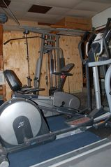 San Fernando house photo - Gym with treadmill, elliptical, reclining bike, weight mach., free weights bench