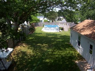 Rehoboth Beach house photo - Spacious fenced-in yard includes above ground pool.