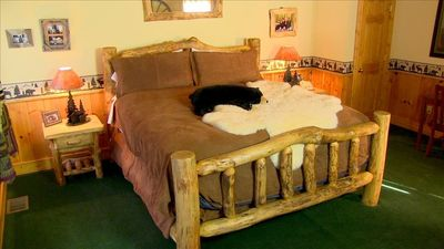 King sized Aspen log bed.  This  bedroom is equipped with real Aspen furniture.
