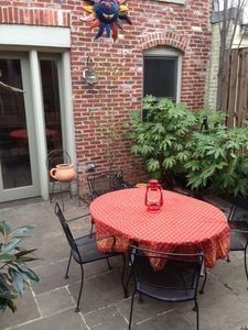 Patio garden with fountain and carriage house behind