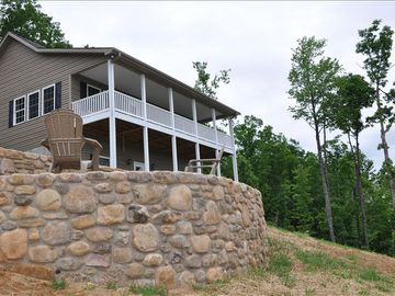 Chimney Rock house rental - Stone walls and the conversation terrace with fire pit lead you to your getaway