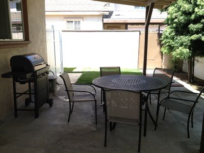 Patio with gas BBQ grill and patio furniture