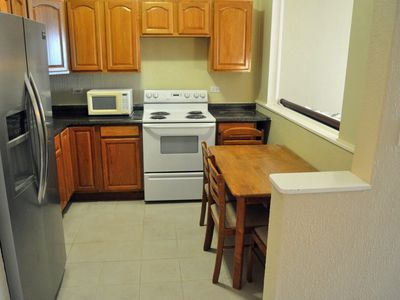 A full size kitchen with stove, fridge (with ice maker), microwave etc.