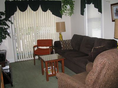 Living room with 42' TV. Sliding glass door leads to screened porch.