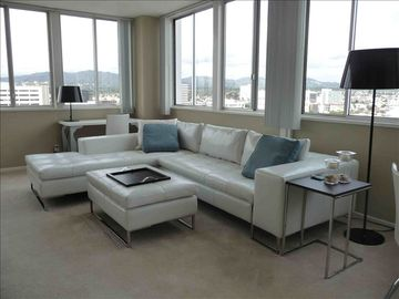 Living room area with ocean & city view. Sofa converts to sofa sleeper. 16th flr