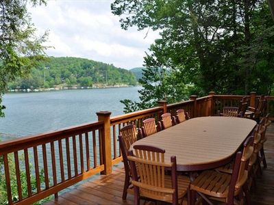 Large outdoor dining are on the upper deck overlooking the lake