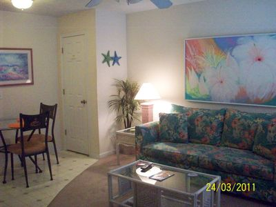 Lower Grand Lagoon condo rental - Sleeper sofa ideal for children or adults. Dining area beside living room.