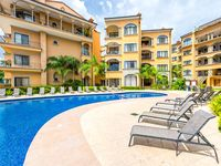 Tropical resort escape with a shared pool, ocean views, and easy beach access