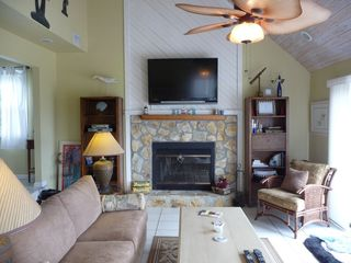 Port St. Joe house photo - Large flat screen tv above a beautiful stone fireplace.