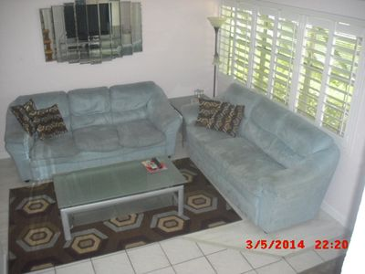 View of living room area from top of stairs.