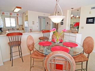 Dining area, breakfast bar and wet bar - Windy Hill condo vacation rental photo