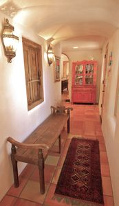 Cute Hall with Saltillo Tile Floor and Antique Doors